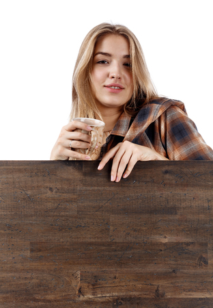 Young pretty woman in brown  plaid shirt with coffee mug . Beautiful girl isolated on white background.