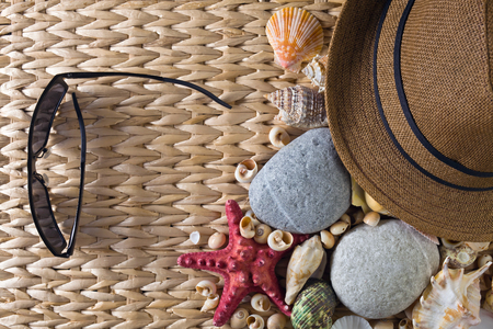Summertime sea vacation background with star fish and shells .