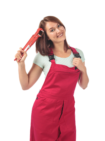 Young happy woman in red jumpsuit with wrench in hand, isolated on white background . Banque d'images