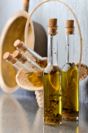 Olive oil with different spices and herbs. Stock Photo