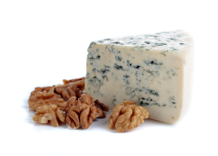 Wedge of soft blue cheese with walnuts isolated on white background.  写真素材