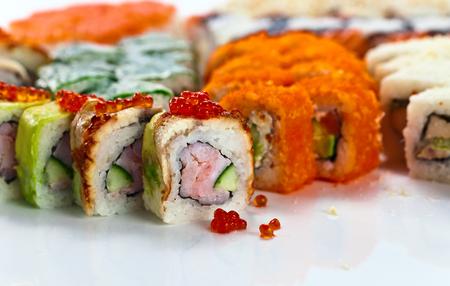 japanese sushi on a white reflexive background