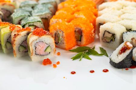 Japanese sushi on a white reflexive background.