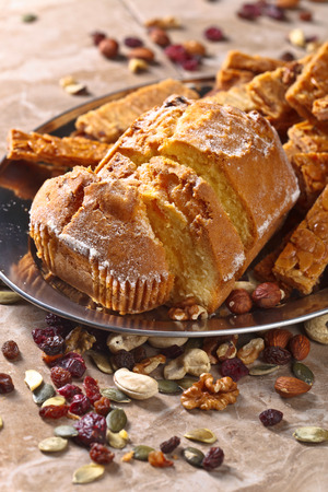 Fresh cupcake with almond cookies , nuts and dried fruits