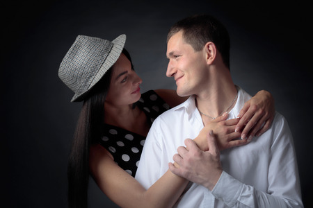 Young beautiful woman in polka dot dress and man in white shirt. Couple in love.