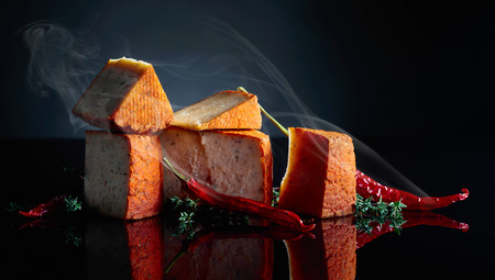 Red Pecorino sheep milk cheese with thyme and red pepper. Traditional sheep cheese produced in southern Italy.