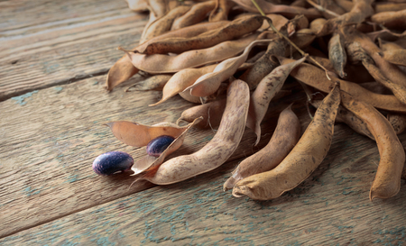Dry bean pods, healthy organic food. Old wooden background.