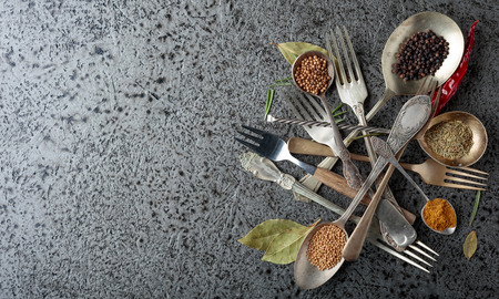 Various herbs and spices on metal table. Top view, copy space. Imagens