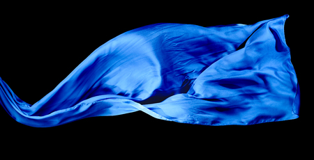 Smooth elegant blue transparent cloth isolated on black background. Texture of flying fabric. 版權商用圖片