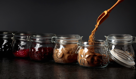 Various Oriental spices and herbs in glass jars. Selective focus. 写真素材