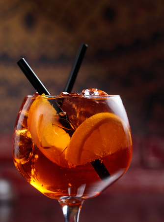Closeup of tasty alcoholic cocktail with orange slices and natural ice. 写真素材