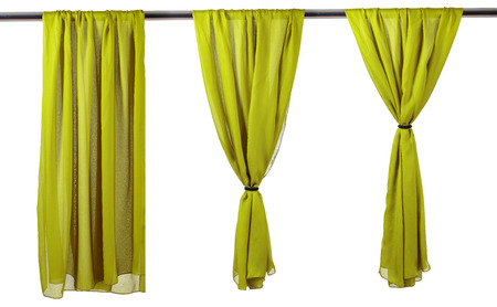 Vertica lgreen satin curtains isolated on white background. Stockfoto