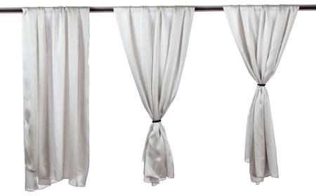 Vertical grey satin curtains isolated on white background.