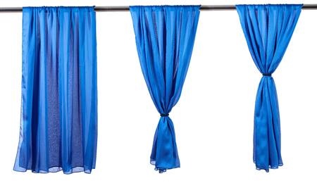 Vertical blue satin curtains isolated on white background. Reklamní fotografie