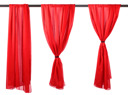 Vertical red satin curtains isolated on white background.