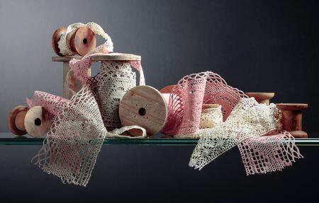 Vintage cotton lace trims on wooden spools. Free space for your text. Banco de Imagens - 124961298