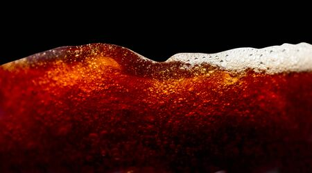 Close up of coffee splashes on a black background. Saved clipping path.