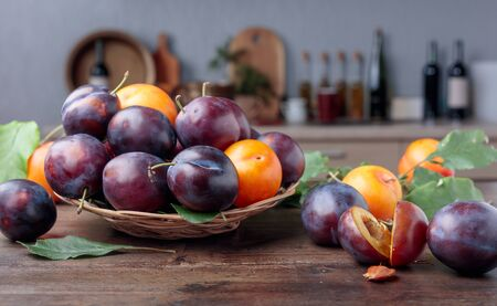 Ripe juicy plums on a old wooden table.  Selective focus.