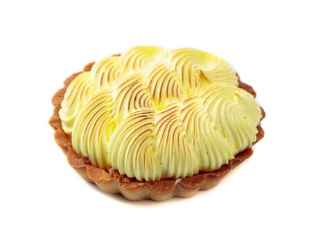 Tartlet with lemon cream isolated on a white background.