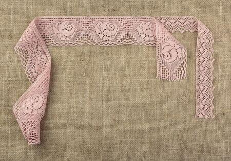 Laces on natural burlap. Top view. Copy space.