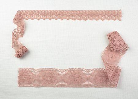 Lace on natural linen fabric. Top view. Copy space. Banco de Imagens