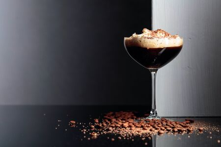 Coffee cocktail with whipped cream and sprinkled with chocolate chips.