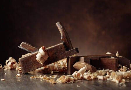 Old wooden jointers and shaving on wooden table. Selective focus.