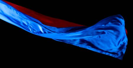 Smooth elegant blue and red transparent cloth isolated on black background. Texture of flying fabric.