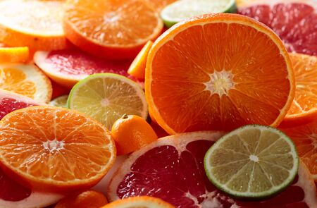 Close up of citrus fruits. Pieces of lemon, lime , tangerine , pink grapefruit and orange. Selective focus.
