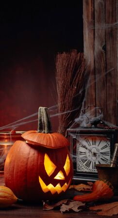 Halloween pumpkins on a old wooden background. Conceptual still life on the theme of Halloween. Copy space. 写真素材