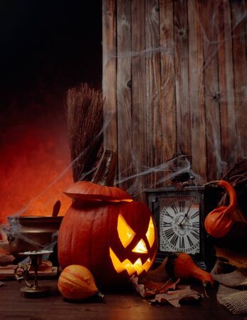Halloween pumpkins on a old wooden background. Conceptual still life on the theme of Halloween. Copy space. Stock Photo