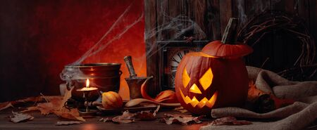 Halloween pumpkins on a old wooden background. Conceptual still life on the theme of Halloween. Copy space. Banco de Imagens