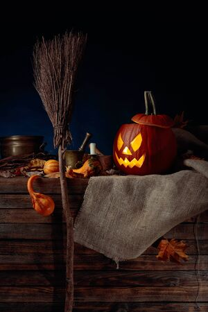 Halloween pumpkins on a old wooden background. Conceptual still life on the theme of Halloween. Copy space. Imagens