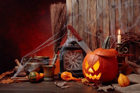 Halloween pumpkins on a old wooden background. Conceptual still life on the theme of Halloween. Copy space.
