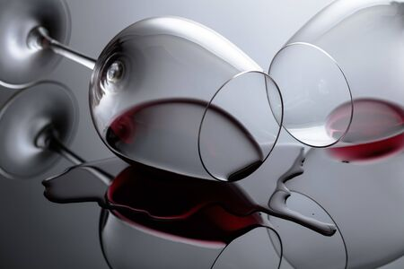 Glasses of red wine on a black reflective background. Selective fokus. Stock Photo