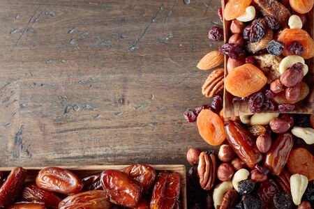 Dried fruits and nuts on a old wooden table. Top view. Archivio Fotografico