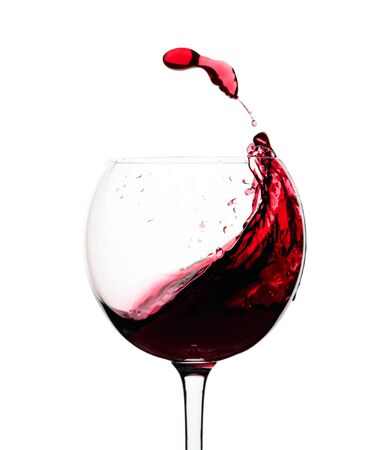 Splash of red wine in a glass isolated on a white background. Stockfoto