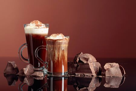 Hot chocolate with whipped cream and pieces of dark chocolate. Copy space.