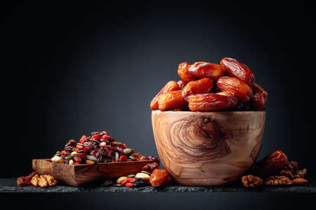 Dates and dried fruits, nuts and seeds. Copy space.