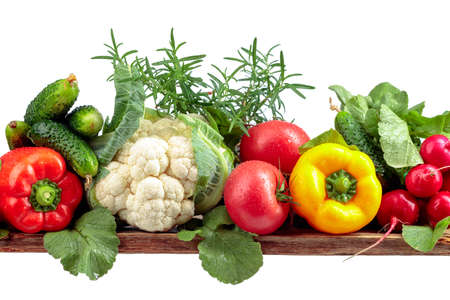 Various fresh raw vegetables, frontal view, isolated on white background.