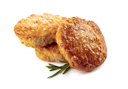 Delicious homemade cutlets with rosemary isolated on a white background.