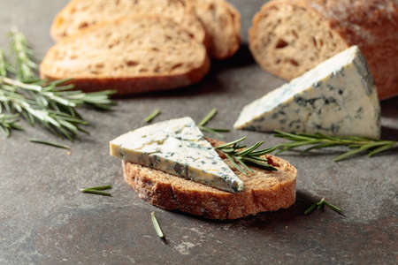 Blue cheese with rosemary and fresh bread.