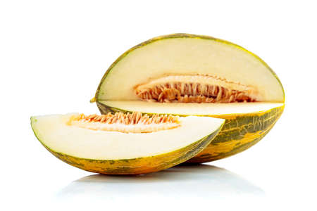 Melon isolated on a white reflective background.