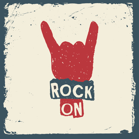 music hand drawn typography poster with sign of the horns. rock on. artwork for wear. vector illustration on grunge background