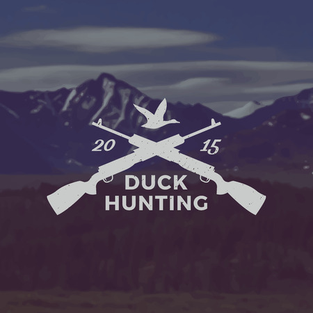 duck hunting: vector duck hunting emblem with grunge texture on mountain landscape background