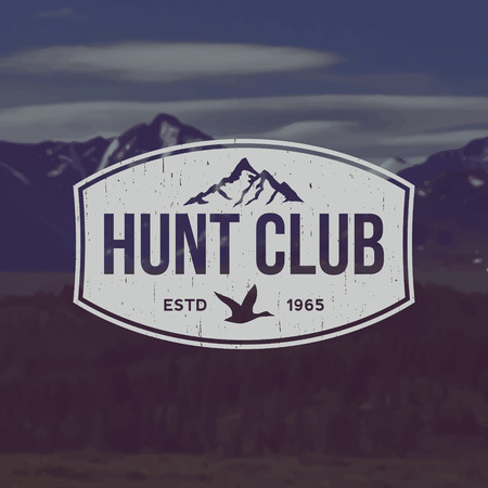 hunting season: vector hunting club emblem with grunge texture on mountain landscape background Illustration