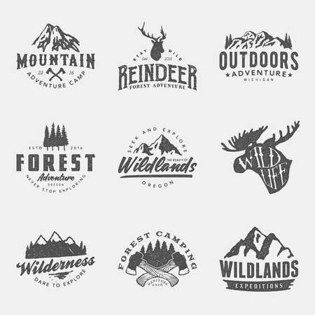 Set of vintage hand drawn outdoor adventure badges and labels.