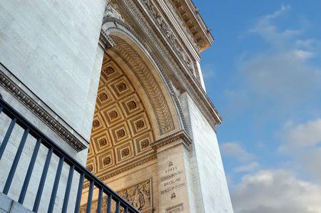 LArc de Triomphe on blue sky background photo