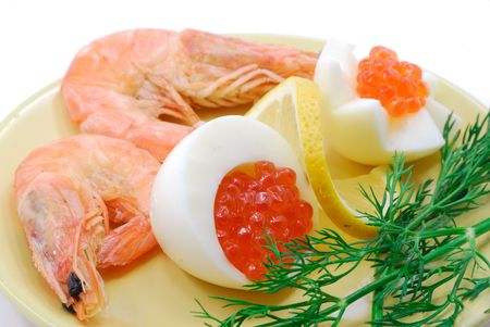 The red salmon caviar and cooked shrimps on porcelain dish photo