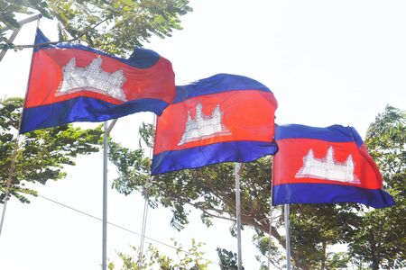 three flags of the kingdom of cambodia in phnom penh holiday in park near king palace